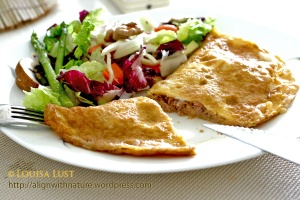Tuna-filled omelet pan-fried with ghee, served with salad