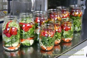 Salad stored in mason jars is kept fresh through the whole week.